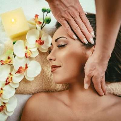 flowers and woman having her neck massaged